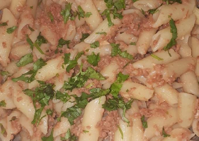 Penne in corned beef garnished with dhania