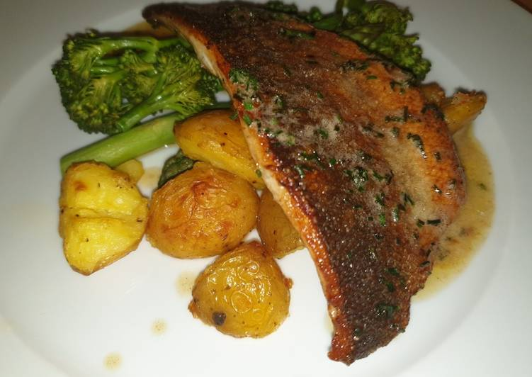 Sea Bass, Crispy Potatoes, Greens & a Brown Butter Chive Sauce