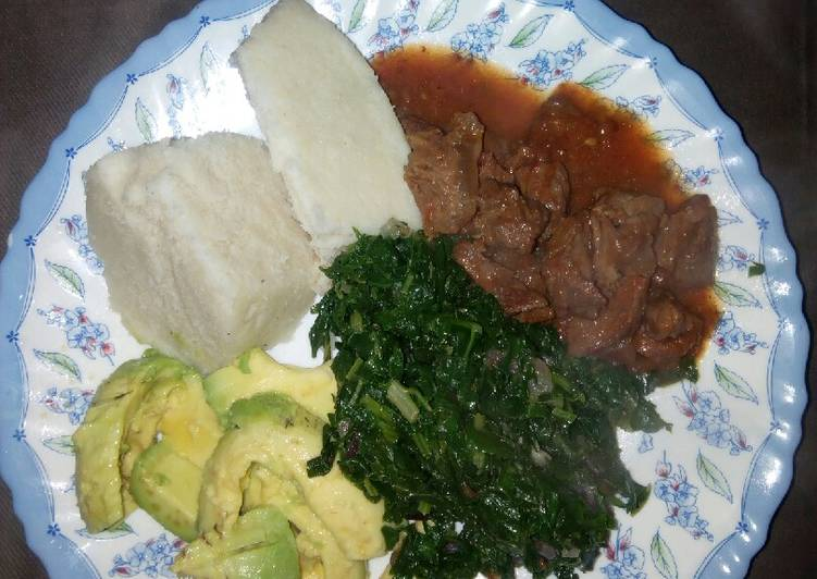 Ugali with wet fry beef n mixed greens/guacamole