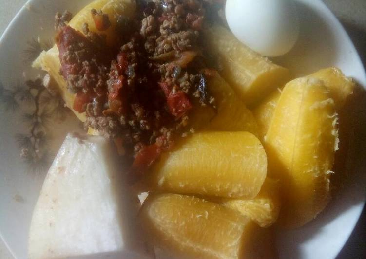 Boiled plantain,boiled yam,boiled egg and sauce