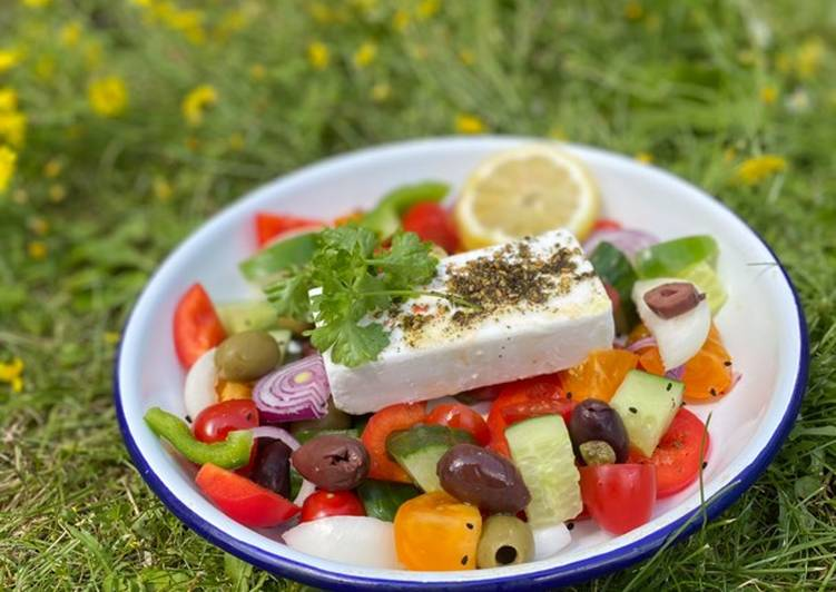 Try Using Food to Improve Your Mood Vegan Greek Salad with green herbs 🌱🌿