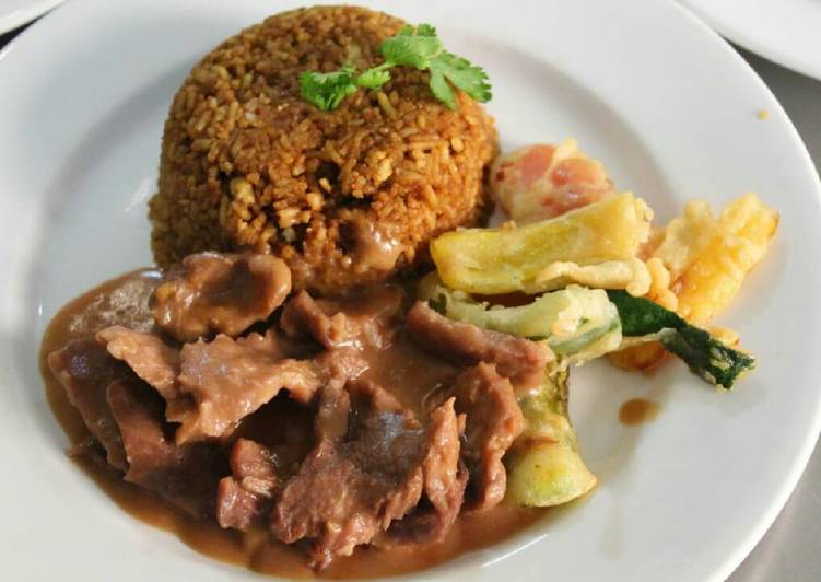 Pilau with braised steak of beef and mixed bell peppers