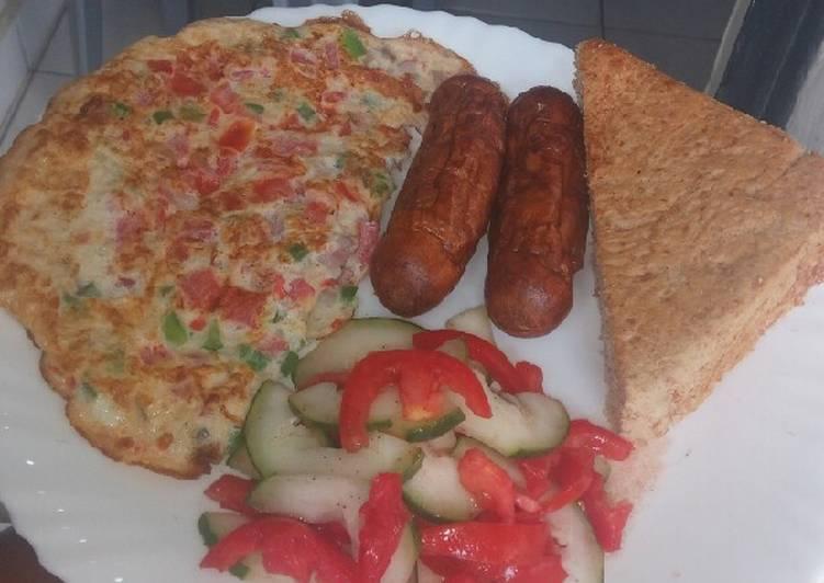 Simple breakfast... omelette,sausages,salad,bread
