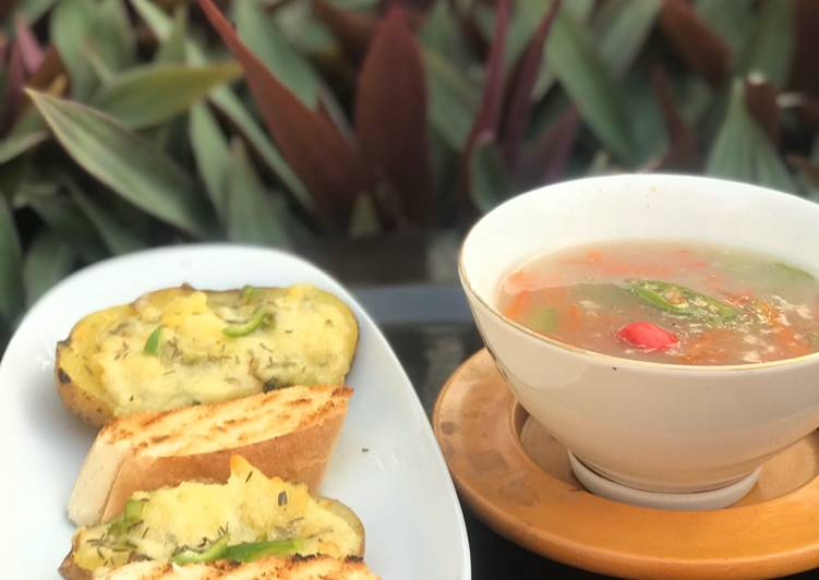 Thai vegetables soup with baked cheesy potatoes
