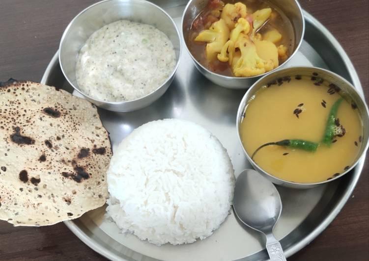 Veg thali with aloo gobhi sabji, turai raita, dal tadka and rice
