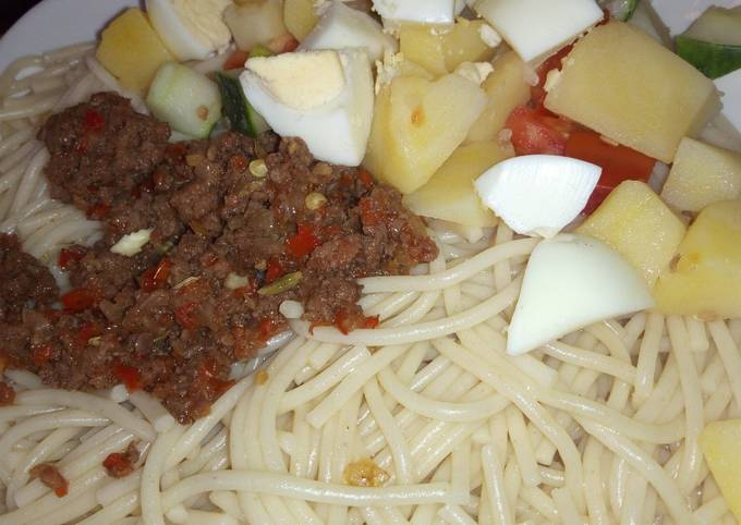 Spaghetti, minced meat sauce and potato salad
