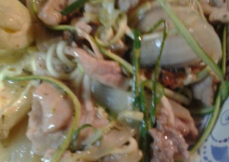 Pork and onions in a wine sauce