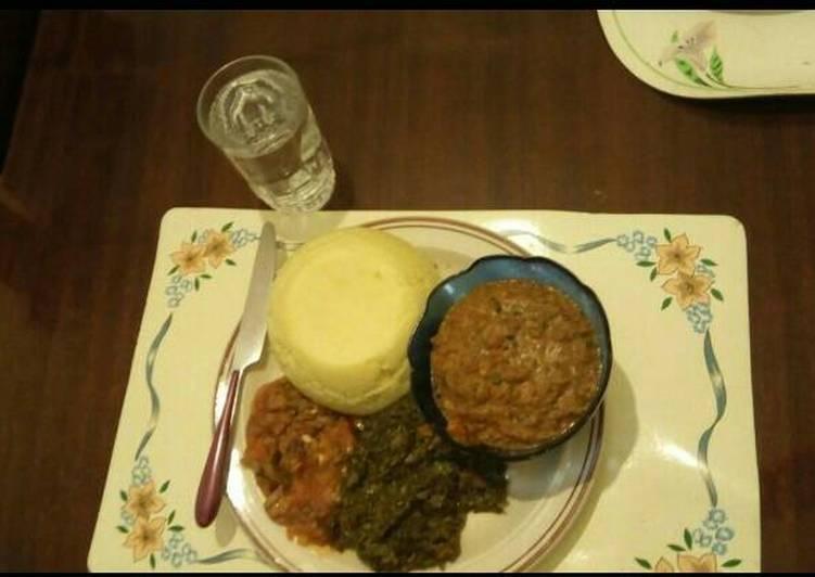 AfricanCake(Ugali) Sauted mushrooms Kenyan greens by Seline