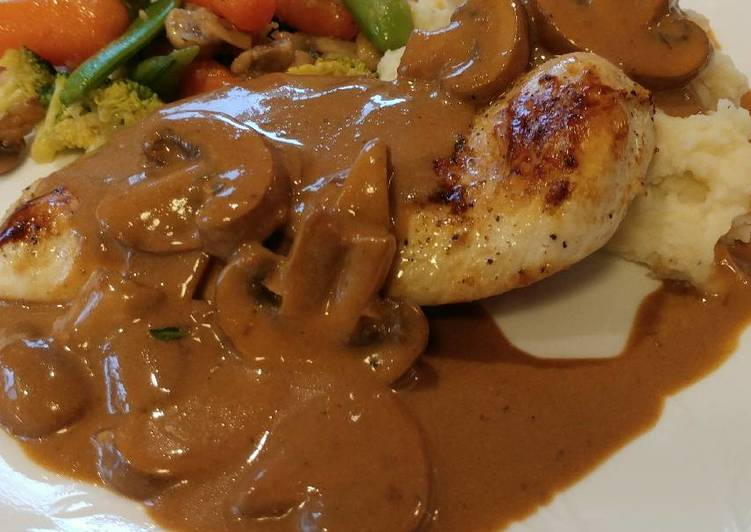 Pan Seared Chicken Breast smothered in a Crimini Mushroom Sauce