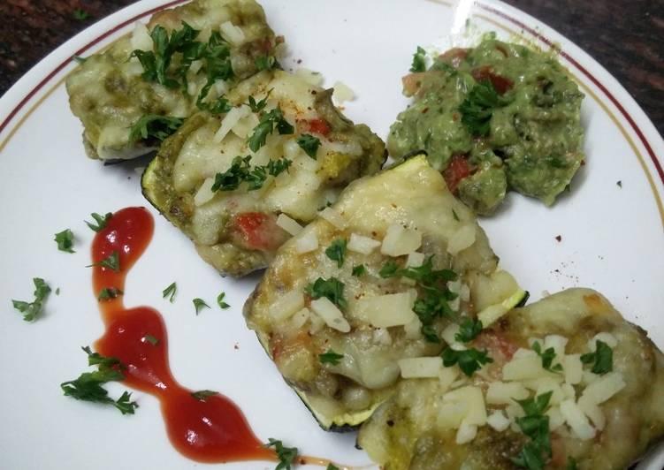 Zucchini stuffed with cheesy Guacamole
