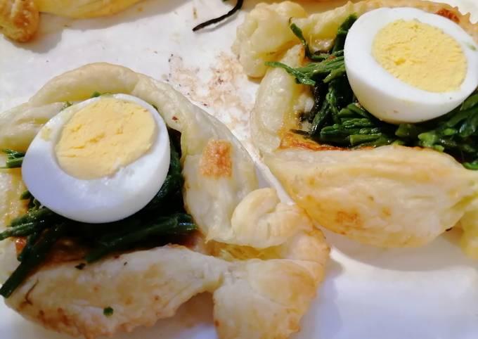 Caramelle di pasta sfoglia ripiene di scamorza asparagi di monte, speck, e uovo sodo