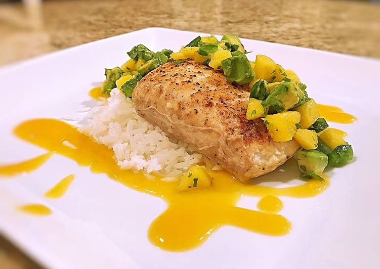 Pan seared halibut on coconut rice with mango habanero peach sauce and mango avocado salsa