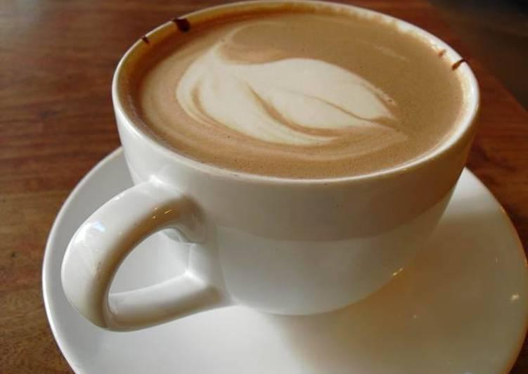 cafe con leche endulzado con miel