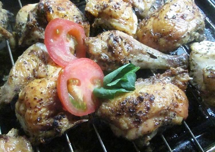 Pollo asado en la parrilla del horno